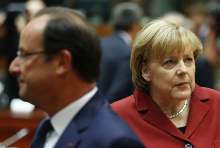 Germany's Chancellor Merkel and France's President Hollande attend a European Union leaders summit in Brussels
